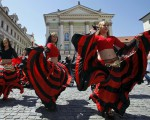 Participants of the Khamoro World Roma Festival dance through the historical centre of Prague