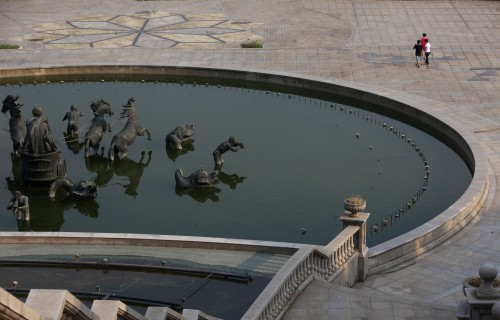 People walk past a fountain at the Tianducheng development in Hangzhou